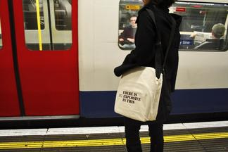 Photo: person wearing black and holding a tote bag...