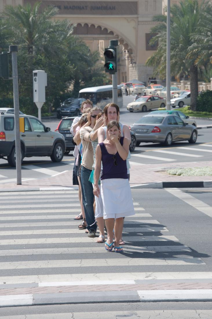 Photo of a queue of people crossing a crosswalk to...