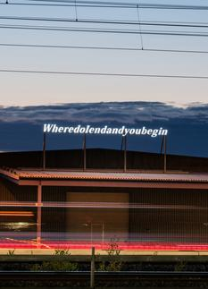 "LED lettering on top of a train station ""where do..."